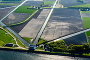 Nederland, Noord-Holland, Medemblik, 07-05-2018; Wieringermeerpolder met gemaal De Lely, een van de twee gemalen verantwoordelijk voor het droogmalen van de Wieringermeer; architect Dirk Roosenburg. <br /> Wieringermeer polder with pumping station De Lely, one of the two pumping stations responsible for the draining of the Wieringermeer.<br /> <br /> <br /> luchtfoto (toeslag op standard tarieven);<br /> aerial photo (additional fee required);<br /> copyright foto/photo Siebe Swart
