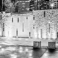 Charlotte Romare Bearden Park fountain waterfall wall at night black and white photo.  Romare Bearden Park is a popular attraction in downtown Charlotte,  North Carolina in the Eastern United States of America. Panoramic photo ratio is 1:3.