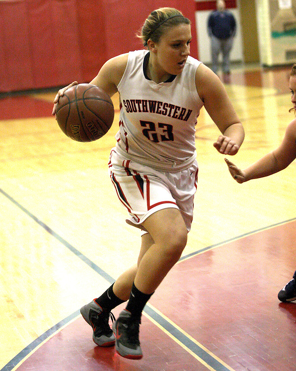 Southwestern's Sydney Burk drives during first quarter action Panama 12-10-15 photo by Mark L Anderson