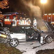 Ongeval met geleende BMW Naarderstraat Huizen..lekkage benzine, schuim, cabrio, brandweer, politie