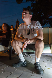 June 11, 2017 - Merrick, New York, United States - CHRIS EDOM, 'American Grit' TV series contestant, 48, of Merrick, wears GOT GRIT? T-shirt as he sits in his backyard with family, friends, neighbors, athis Viewing Party for Season 2 premiere of the FOX network reality television series. (Credit Image: © Ann Parry via ZUMA Wire)