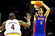 Feb. 9, 2011; Cleveland, OH, USA; Detroit Pistons small forward Austin Daye (5) shoots over Cleveland Cavaliers power forward Antawn Jamison (4) during the fourth quarter at Quicken Loans Arena. The Pistons beat the Cavaliers 103-94 for Cleveland's 26th loss in a row. Mandatory Credit: Jason Miller-US PRESSWIRE
