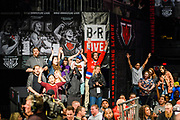 Baltimore, Maryland - May 17, 2018: Audience members cheer in front of World Armwrestling League and Bleacher Report Live branding during the World Armwrestling League Supermatch Showdown Series at Rams Head Live in Baltimore, Thursday May 17th, 2018. Bleacher Report Live is the exclusive broadcaster of the event. With the recent advent of online video streaming services, niche sporting leagues are now able to sign broadcast deals. <br /> <br /> <br /> CREDIT: Matt Roth for The New York Times<br /> Assignment ID: 30219819A