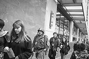 2017 MARCH 05 - People walk up Pine St near Emerald City Comicon, downtown, Seattle, WA, USA. By Richard Walker