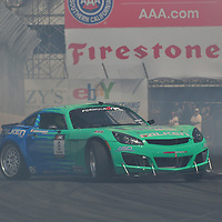 Darren McNamra competing in the Formula DRIFT 2012 at Toyota Grand Prix of Long Beach Street Course