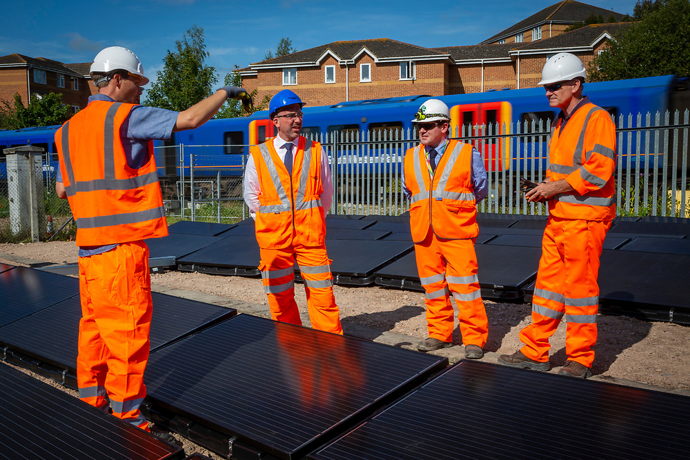 Leo Murray, director of innovation at 10:10 Climate Action with Stuart Kistruck director of asset management for network rail Wessex route, <br /> Patrick Flanagan of Network Rail and Martin Heath from Basingstoke Energy Service at the array of solar panels next to the line near Aldershot Railway Station.  This innovative project is the first in the UK to power the railway with electricity generated from solar power and, if successful, could see many Network Rail sites across the country adapting this sustainable energy approach. Riding Sunbeams is a social enterprise, run by 10:10 Climate Action. Built with Community Energy South and partnered with Network Rail and The Department for Transport and by InnovateUK.  Aldershot, Hampshire, United Kingdom. Riding Sunbeams is a world leading project to connect solar panels directly into electrified rail routes to power the trains. Direct supply of solar power to rail traction systems has never been done. But it has huge potential - from metros, trams and railways in the UK and around the world.<br /> (photo by Andrew Aitchison / In Pictures via Getty Images)