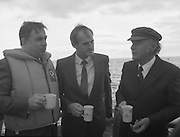 Round Europe Yacht Race.   (R61)..1987..25.07.1987..07.25.1987..25th July 1987..President Patrick Hillery started the Round Europe Yacht Race which began at Dun Laoghaire today...Photograph shows Commissioner Peter Sutherland in conversation with Mr Michael Noonan TD, Minister for Defence and President Patrick Hillery aboard the Dun Laoghaire Lifeboat..