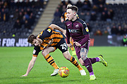 Swansea City midfielder Barrie McKay (19) beats Hull City forward Chris Martin (29)  during the EFL Sky Bet Championship match between Hull City and Swansea City at the KCOM Stadium, Kingston upon Hull, England on 22 December 2018.