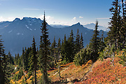 Big Four Mountain, Hall Peak, Mount Pilchuck, and the valley of the South Fork of the Stillaguamish River are seen from Mount Dickerman Trail #710 in Mount Baker-Snoqualmie National Forest. Start hiking from the trailhead on the Mountain Loop Highway east of Verlot, Washington, USA.