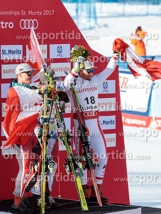 12.02.2017, St. Moritz, SUI, FIS Weltmeisterschaften Ski Alpin, St. Moritz 2017, Abfahrt, Herren, Flowerzeremonie, im Bild v.l. Erik Guay (CAN, Herren Abfahrt Silbermedaille), Beat Feuz (SUI, Herren Abfahrt Weltmeister), Max Franz (AUT, Herren Abfahrt Bronzemedaille) // f.l. men's Downhill Silver medalist Erik Guay of Canada men's Downhill world Champion and Gold medalist Beat Feuz of Switzerland men's Downhill Bronze medalist Max Franz of Austria during the Flowers ceremony of men's Downhill of the FIS Ski World Championships 2017. St. Moritz, Switzerland on 2017/02/12. EXPA Pictures © 2017, PhotoCredit: EXPA/ Johann Groder