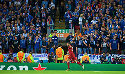 LIVERPOOL, ENGLAND - Wednesday, August 23, 2017: Liverpool's Emre Can celebrates scoring the first goal as TSG 1899 Hoffenheim supporters looks dejected during the UEFA Champions League Play-Off 2nd Leg match between Liverpool and TSG 1899 Hoffenheim at Anfield. (Pic by David Rawcliffe/Propaganda)