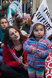 London, UK. 2 December, 2019. Climate activist mothers from XR Families nurse their babies outside the headquarters of the Conservative Party as part of a roving nurse-in outside the premises of the various political parties to demand that they put the climate and ecological emergency at the heart of their general election campaigns.
