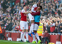 Football - 2018 / 2019 Premier League - Arsenal vs. Southampton<br /> <br /> Alexandre Lacazette (Arsenal FC) leaps into the arms of Pierre-Emerick Aubameyang (Arsenal FC) after scoring at The Emirates.<br /> <br /> COLORSPORT/DANIEL BEARHAM