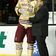 Kevin Hayes #12 of the Boston College Eagles receives the Most Valuable Player award following The Beanpot Championship Game at TD Garden on February 10, 2014 in Boston, Massachusetts. (Photo by Elan Kawesch)