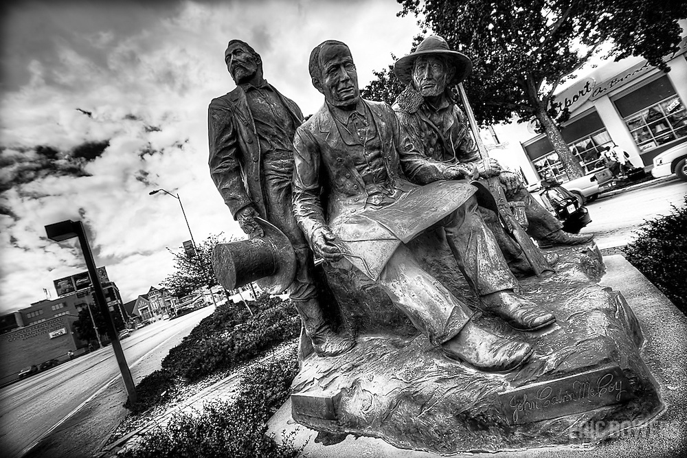 """The Pioneers"" sculpture group at Pioneer Park at Westport Rd and Broadway, Kansas City, Missouri."