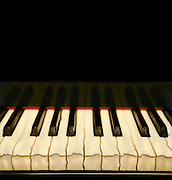 Graphic image black and white in color of piano keys hand altered Polaroid photograph