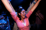 PERUVIAN FEMALE ARMS IN THE AIR CHEERING ,CLUBBING.