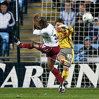 Photo: Steve Bond.<br /> Coventry City v West Ham United. Carling Cup. 30/10/2007. Andy Marshall (R) clears under pressure from the incoming Luis Boa Morte (L)