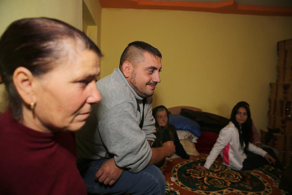 Razvan's aunt on the left, Razvan, and his grand-ma (dad's side) and his cousin