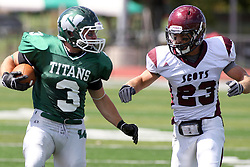 08 September 2012:  T.J Stinde looks off Luke Kanine as he hustles up the field during an NCAA division 3 football game between the Alma Scots and the Illinois Wesleyan Titans which the Titans won 53 - 7 in Tucci Stadium on Wilder Field, Bloomington IL