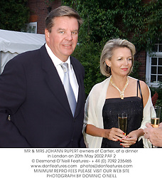 MR & MRS JOHANN RUPERT owners of Cartier, at a dinner in London on 20th May 2002.PAF 2