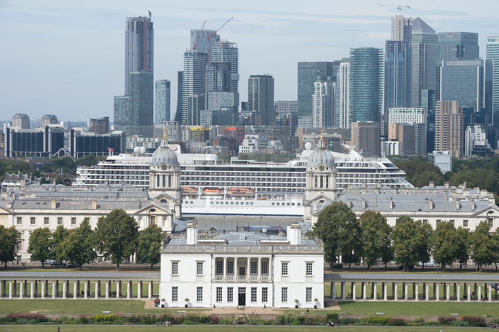 ©Licensed to London News Pictures 30/08/2019.<br /> Greenwich ,UK. The Queen's House in the foreground as the Viking Sun cruise ship from Norway is pulled backwards down the River Thames this afternoon so it can dock next to the Cutty Sark in Greenwich, London.  Photo credit: Grant Falvey/LNP