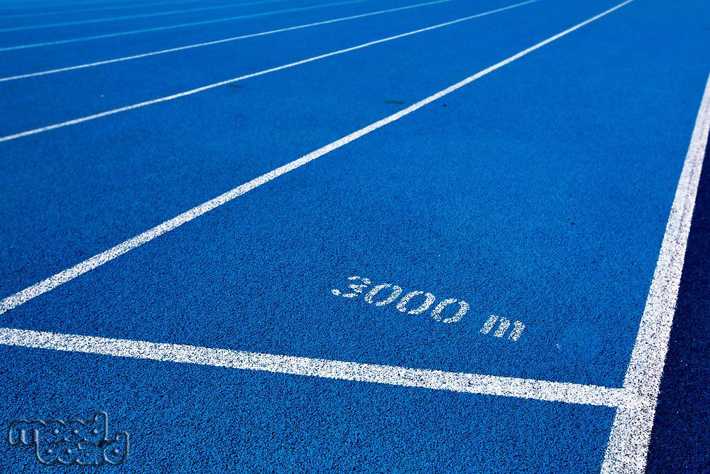 Photo of blue 3000 meter running tracks