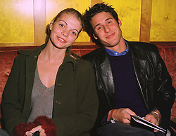 MISS JEMMA KIDD and MR DAVID DE ROTHSCHILD a member of the banking family, at a party in London on 12th January 1999.MND 4