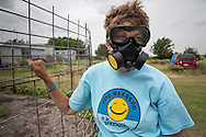 Lynn  D. Buerhring wears a respirator when she goes outside of her home  in Karnes City, in the Eagle Ford Shale in Texas where fracking is booming. Her health has been negatively impacted by the chemicals in the air emitted by the thirty fracking industry sites near by. She had to close her accounting business becuase she can no longer concentrate on work due to migraine headaches.