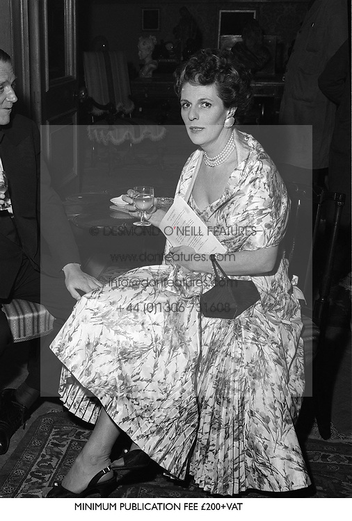 The HON.MRS SHAND mother of Camilla Parker Bowles, at a reception at Christies London in December 1957.