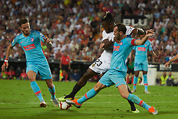 August 20, 2018 - Valencia, U.S. - VALENCIA, SPAIN  - AUGUST 20:  Michy  batshuayi forward of Valencia cf competes for the ball with Diego Godin defender and Saul I–iguez midfielder  of Atletico de Madrid during the La Liga between Valencia CF and Atletico de Madrid on August 20, 2018 at Mestalla in Valencia, Spain. (Photo by Carlos Sanchez Martinez/Icon Sportswire) (Credit Image: © Carlos Sanchez Martinez/Icon SMI via ZUMA Press)