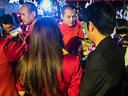 01 JANUARY 2016 - BANGKOK, THAILAND:          Buddhist monks participate in a merit making ceremony at a nightclub in Bangkok at the end of the club's  New Year's Eve party. Thais usually go to temples and religious observances to meditate and make merit on New Year's Day.      PHOTO BY JACK KURTZ
