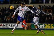 Picture by David Horn/Focus Images Ltd +44 7545 970036<br /> 28/01/2014<br /> Ryan Fredericks of Millwall attempts to block a shot from Atdhe Nuhiu of Sheffield Wednesday during the Sky Bet Championship match at The Den, London.