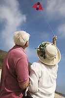 Couple flying kite outdoors
