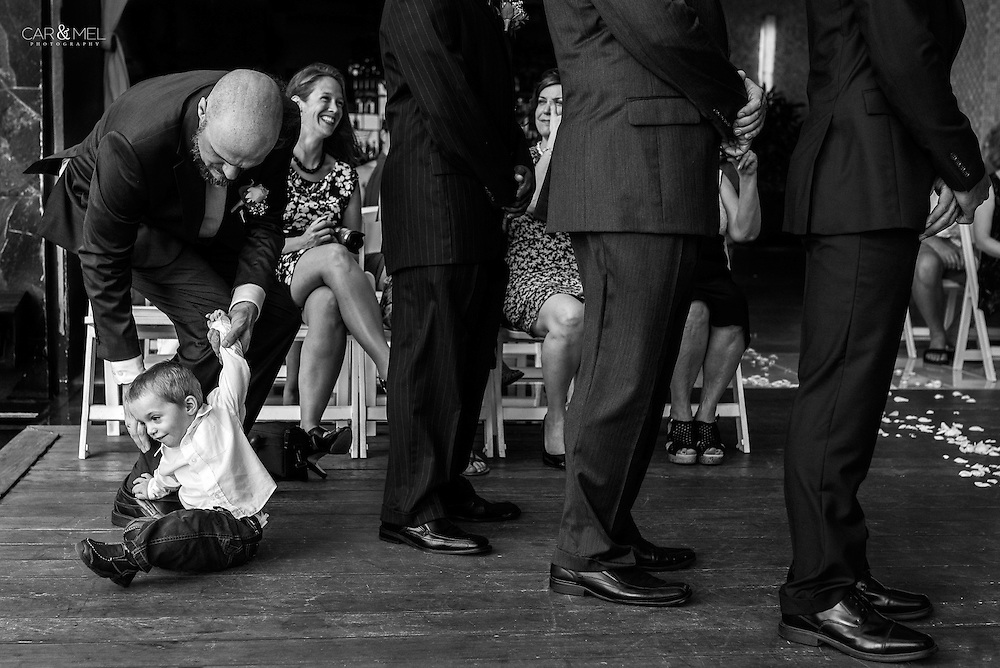 Celia and Andrew's ring bearer misbehaving during their ceremony at the Now Amber Resort in Puerto Vallarta, Mexico. Photo by: Juan Carlos Calderón