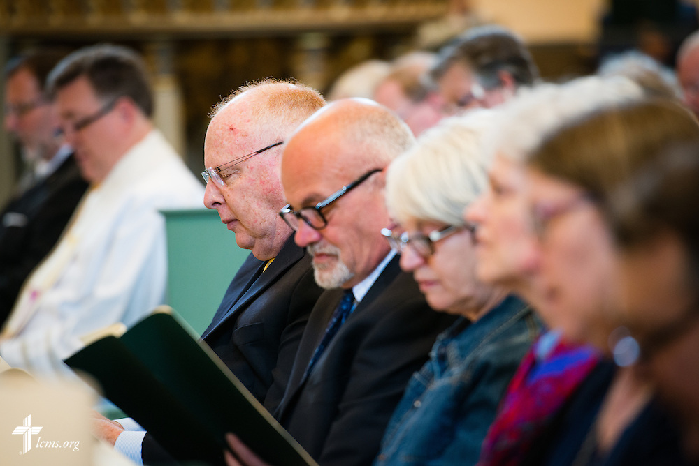 Rich Robertson of the Lutheran Church Extension Fund prays during the Festival Dedication Service at the Town and Parish Church of St. Mary's before the dedication of The International Lutheran Center at the Old Latin School on Sunday, May 3, 2015, in Wittenberg, Germany. LCMS Communications/Erik M. Lunsford