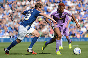 Goalscorer Nick Blackman on the ball against Jonathan Spector during the Sky Bet Championship match between Birmingham City and Reading at St Andrews, Birmingham, England on 8 August 2015. Photo by Alan Franklin.