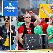 NLD/Amsterdam/20100807 - Boten tijdens de Canal Parade 2010 door de Amsterdamse grachten. De jaarlijkse boottocht sluit traditiegetrouw de Gay Pride af. Thema van de botenparade was dit jaar Celebrate, AVRO boot,