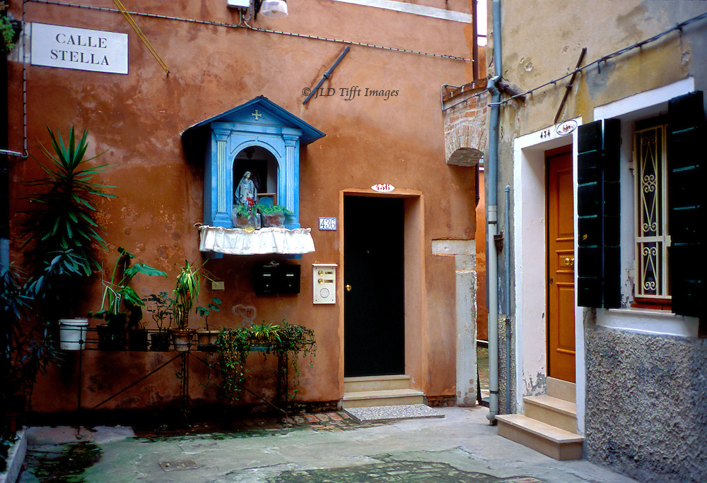 Small corte in Venice, off Calle Stella, in Canareggio.  Doorways to apartments evidently well maintained.  A new shrine to the Virgin Mary on one of the walls.