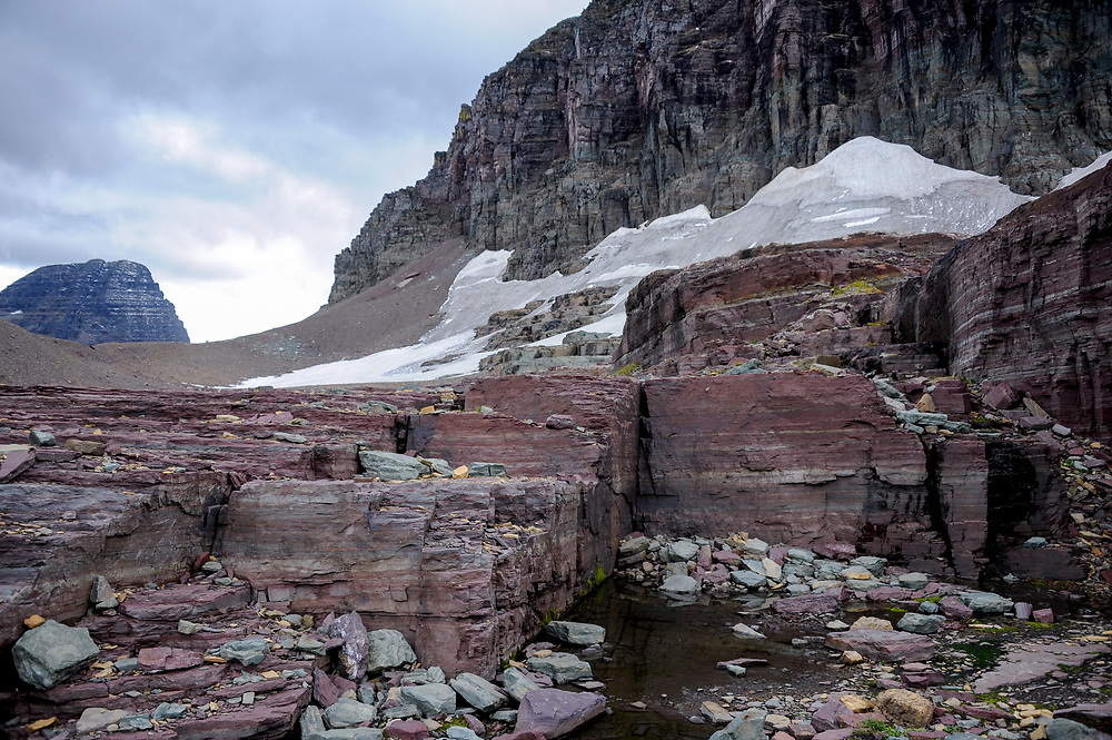 Debris left by a melting glacier at the base of Mount Clements at Logan Pass, Glacier National Park, Montana , Tuesday, October 7, 2014. According to Dan Fagre Ph.D. rocky debris fields are created when a glacier melts and the rocks within it are no longer suspended in ice and fall to the ground.