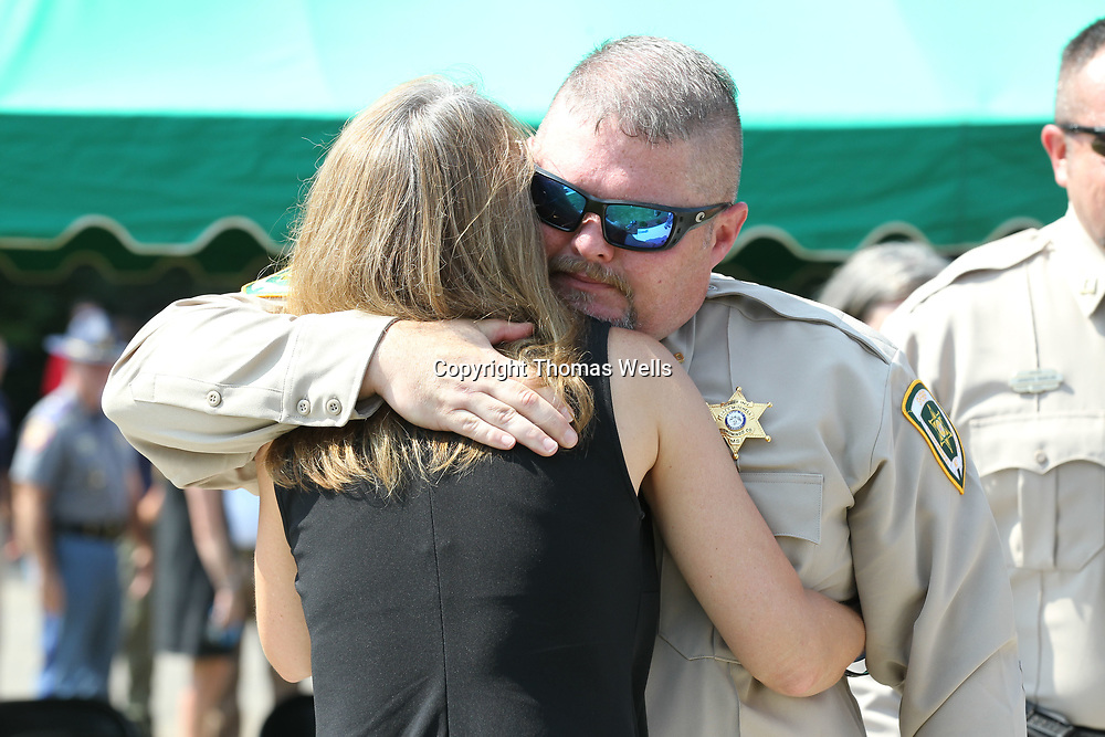 Tishomingo County Sheriff Chief Investigator Greg Mitchell gives Deborah Tartt a hug following the ceremony honoring her husband, Lee, who was killed during a 2016 standoff.