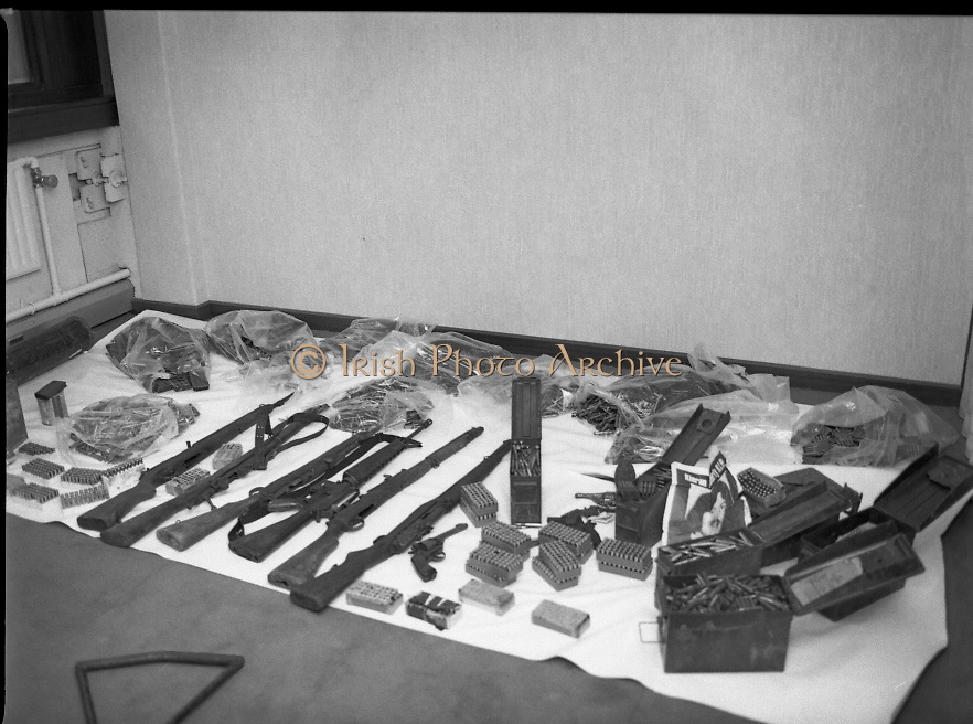 Garda Arms Find.1982.02.02.1982..02.02.1982.2nd February 1982.Pictured at Garda Headquarters Phoenix Park ,Dublin. .Gardai display  their find of Firearms, ammunition and explosives   ..The haul which included armalite rifles also included a poster depicting the 1981 Hunger Striker, Kieran Doherty.