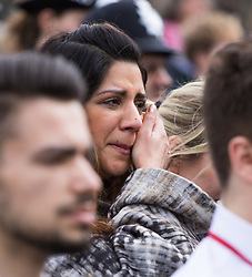 Westminster, London, March 29th 2017. Police officers, members of the emergency services and a large contingent of Muslims from across the UK as well as members of the public march across Westminster Bridge, exactly a week after the terror attack. PICTURED: A woman weeps as the crowd observes a moment of silence.