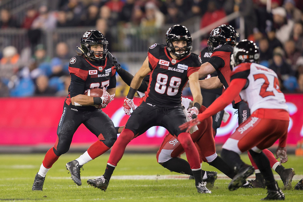 Kienan Lafrance of the Ottawa Redblacks runs the ball during the first quarter of the 104th Grey Cup Final game against the Calgary Stampeders in Toronto Ontario, Sunday,  November 27, 2016.  (CFL PHOTO - Geoff Robins)