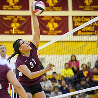 Tohatchi Cougar Latisha Halona (31) spikes the ball over to the Crownpoint Eagles Tuesday at Tohatchi High School.