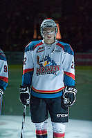 KELOWNA, CANADA, DECEMBER 27: Mackenzie Johnston #22 of the Kelowna Rockets stands in the starting line up as the Spokane Chiefs visit the Kelowna Rockets on December 7, 2011 at Prospera Place in Kelowna, British Columbia, Canada (Photo by Marissa Baecker/Getty Images) *** Local Caption ***