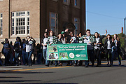 The Cutler Scholars wave during the homecoming parade.