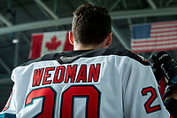 KELOWNA, BC - JANUARY 4: Matthew Wedman #20 of the Kelowna Rockets stands on the bench during the national anthem against the Vancouver Giants at Prospera Place on January 4, 2020 in Kelowna, Canada. Wedman was selected in the 2019 NHL entry draft by the Florida Panthers. (Photo by Marissa Baecker/Shoot the Breeze)