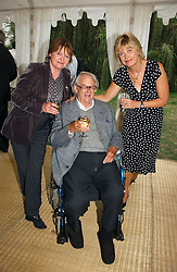 Left to right, SIR JOHN & LADY MORTIMER and ELIZABETH CLOUGH wife of Jeremy Paxman at a party to celebrate the publication of Notting Hell by Rachel Johnson held in the gardens of 1 Rosmead Road, London W11 on 4th September 2006.<br />