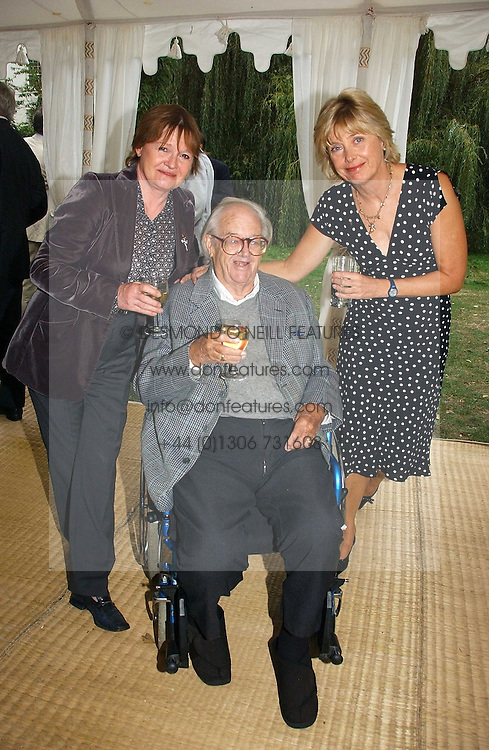 Left to right, SIR JOHN &amp; LADY MORTIMER and ELIZABETH CLOUGH wife of Jeremy Paxman at a party to celebrate the publication of Notting Hell by Rachel Johnson held in the gardens of 1 Rosmead Road, London W11 on 4th September 2006.<br />